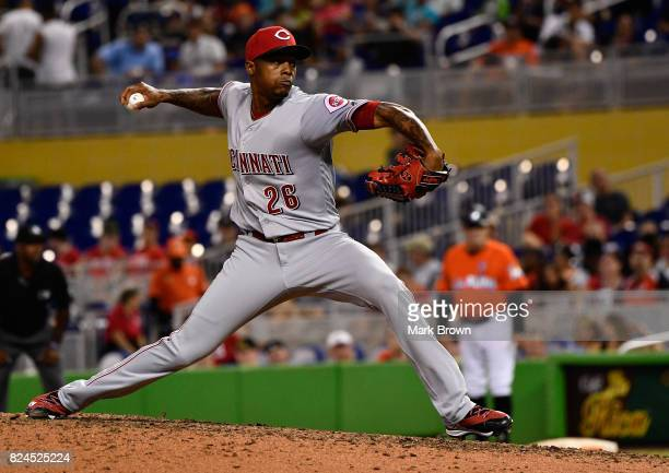 Raisel Iglesias of the Cincinnati Reds pitches the ninth inning during the game between the Miami Marlins and the Cincinnati Reds at Marlins Park on...