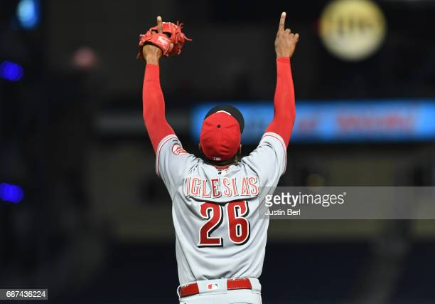 Raisel Iglesias of the Cincinnati Reds reacts after the final out in the Cincinnati Reds 62 win over the Pittsburgh Pirates at PNC Park on April 11...
