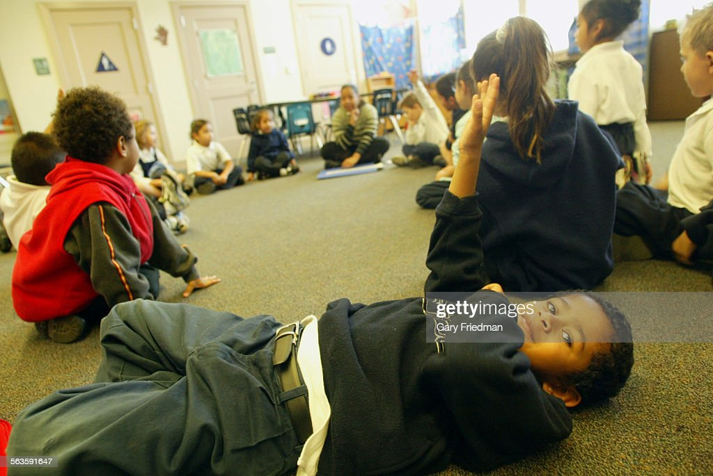 FREDERICKS raises his hand in full–day kindergarten class in Cassandra Johnson's kindergarten class on 12/3/04 at Daniel Webster Elementary in...