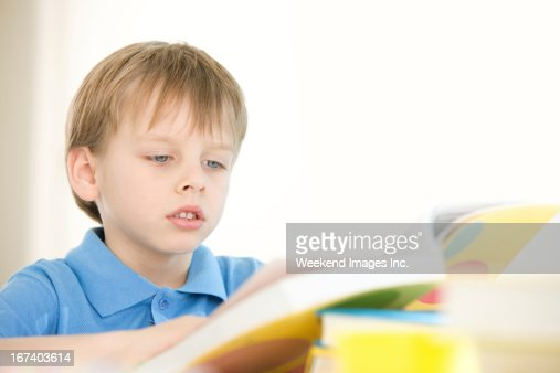 Raising a reader : Stock Photo
