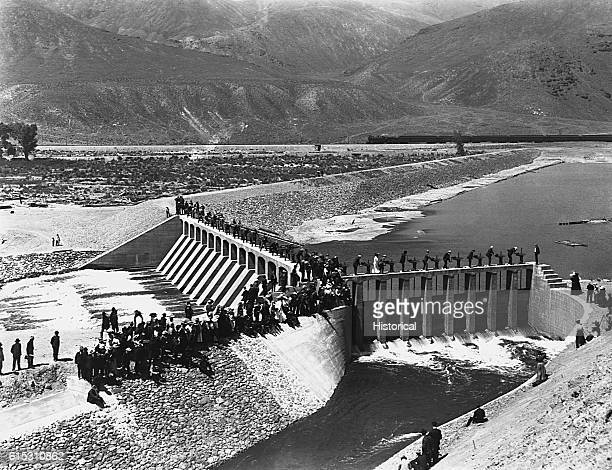 Raising and lowering gates on newly completed diversion dam at the head of the main Truckee canal on the Truckee River at the opening of the...