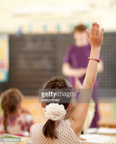 Raising Hands in Elementary Classroom
