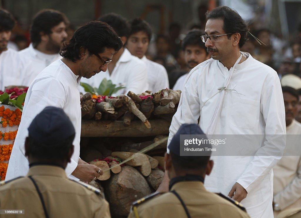 <a gi-track='captionPersonalityLinkClicked' href=/galleries/search?phrase=Raj+Thackeray&family=editorial&specificpeople=836761 ng-click='$event.stopPropagation()'>Raj Thackeray</a> and <a gi-track='captionPersonalityLinkClicked' href=/galleries/search?phrase=Uddhav+Thackeray&family=editorial&specificpeople=4252113 ng-click='$event.stopPropagation()'>Uddhav Thackeray</a> perform the last rites during Bal Thackeray's funeral at Shivaji Park on November 18, 2012 in Mumbai, India. Bal Thackeray passed away on November 17, 2012 at the age of 86 years.