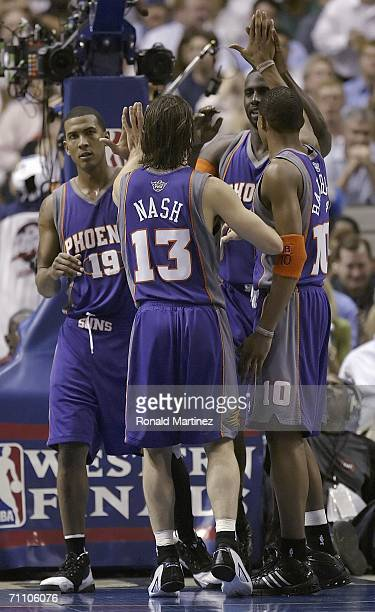 Raja Bell Steve Nash Tim Thomas and Leandro Barbosa of the Phoenix Suns celebrate as they make a run on the Dallas Mavericks in game five of the...