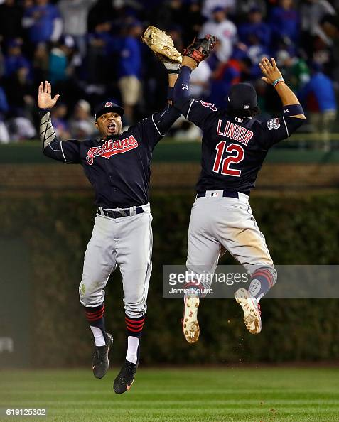 Rajai Davis and Francisco Lindor of the Cleveland Indians celebrate after beating the Chicago Cubs 72 in Game Four of the 2016 World Series at...
