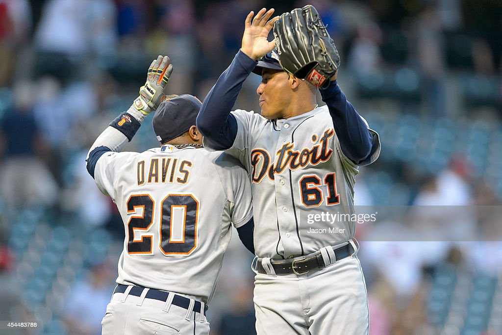 <a gi-track='captionPersonalityLinkClicked' href=/galleries/search?phrase=Rajai+Davis&family=editorial&specificpeople=810608 ng-click='$event.stopPropagation()'>Rajai Davis</a> #20 celebrates with <a gi-track='captionPersonalityLinkClicked' href=/galleries/search?phrase=Ezequiel+Carrera&family=editorial&specificpeople=6778888 ng-click='$event.stopPropagation()'>Ezequiel Carrera</a> #61 of the Detroit Tigers after the Tigers defeated the Cleveland Indians at Progressive Field on September 1, 2014 in Cleveland, Ohio. The Tigers defeated the Indians 12-1.