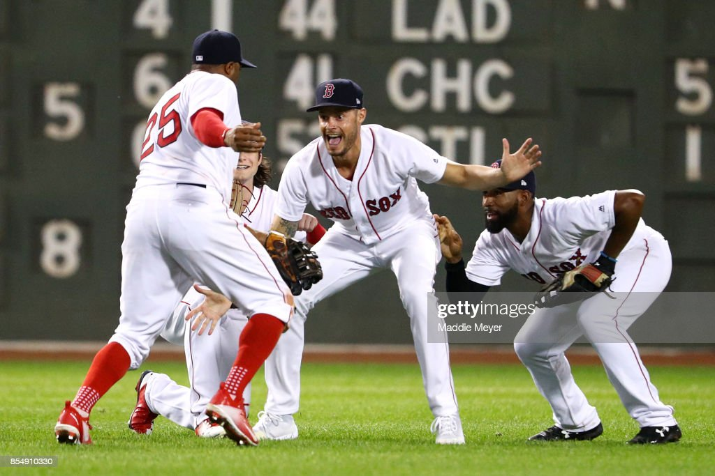 Rajai Davis #25 of the Boston Red Sox, Andrew Benintendi #16, Joe Kelly #56, and Jackie Bradley Jr. #19 celebrate after defeating the Toronto Blue Jays 10-7 at Fenway Park on September 27, 2017 in Boston, Massachusetts.