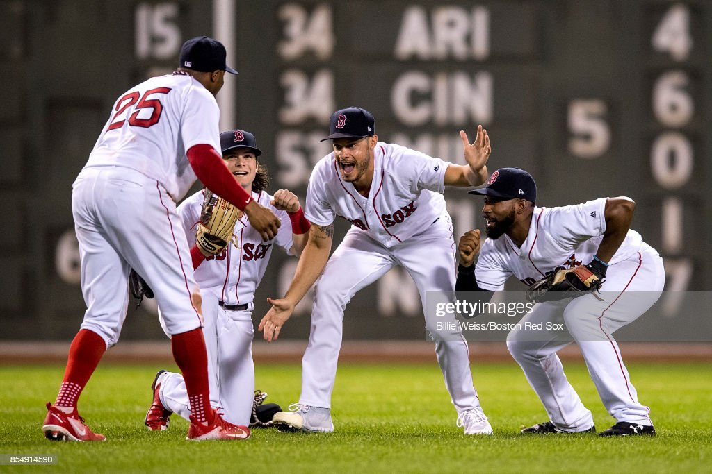 Rajai Davis #25 of the Boston Red Sox, Andrew Benintendi #16, Joe Kelly #56, and Jackie Bradley Jr. #19 celebrate a victory against the Toronto Blue Jays on September 27, 2017 at Fenway Park in Boston, Massachusetts.