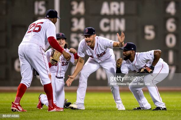 Rajai Davis of the Boston Red Sox Andrew Benintendi Joe Kelly and Jackie Bradley Jr #19 celebrate a victory against the Toronto Blue Jays on...
