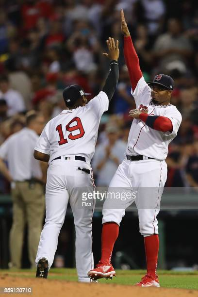 Rajai Davis of the Boston Red Sox celebrates with Jackie Bradley Jr #19 after defeating the Houston Astros 103 in game three of the American League...