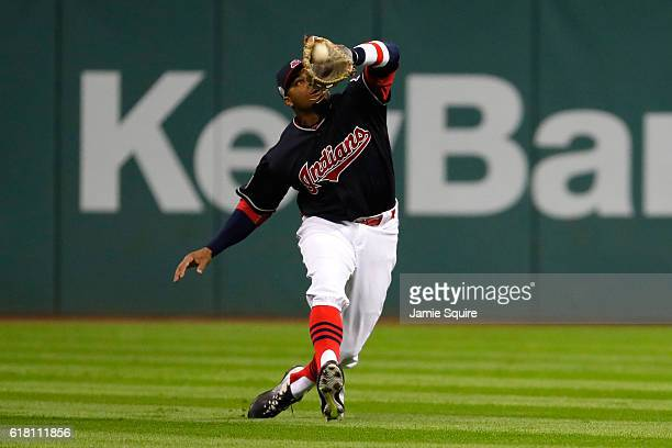 Rajai Davis of the Cleveland Indians catches a fly ball hit by Anthony Rizzo of the Chicago Cubs during the eighth inning in Game One of the 2016...