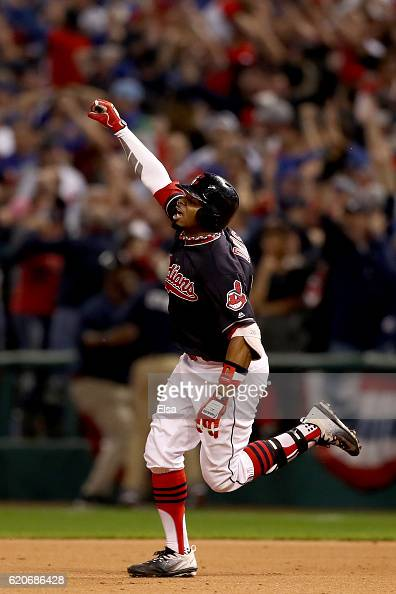 Rajai Davis of the Cleveland Indians celebrates after hitting a tworun home run during the eighth inning to tie the game 66 against the Chicago Cubs...