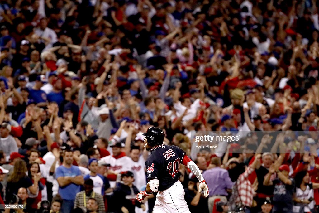 Rajai Davis #20 of the Cleveland Indians celebrates as he runs the bases after hitting a two-run home run during the eighth inning to tie the game 6-6 against the Chicago Cubs in Game Seven of the 2016 World Series at Progressive Field on November 2, 2016 in Cleveland, Ohio.