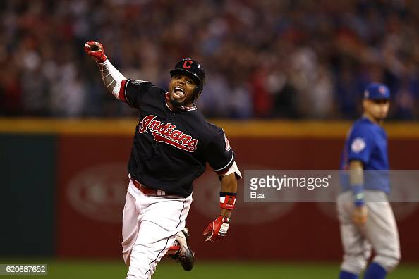 Rajai Davis of the Cleveland Indians celebrates as he runs the bases after hitting a tworun home run during the eighth inning to tie the game 66...