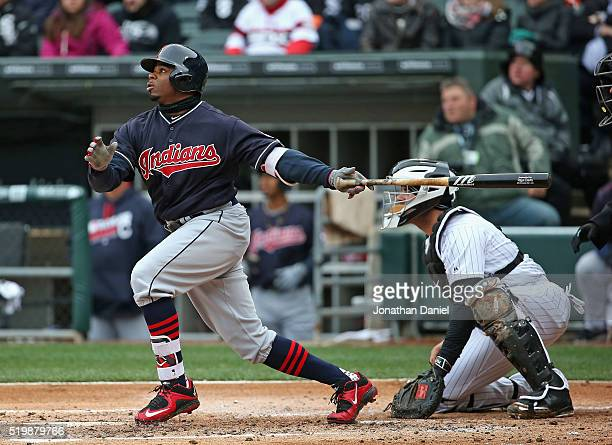 Rajai Davis of the Cleveland Indians hits a run scoring triple in the 2nd inning against the Chicago White Sox during the home opener at US Cellular...