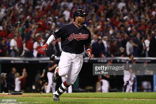 Rajai Davis of the Cleveland Indians runs after hitting a tworun home run during the eighth inning to tie the game 66 against the Chicago Cubs in...