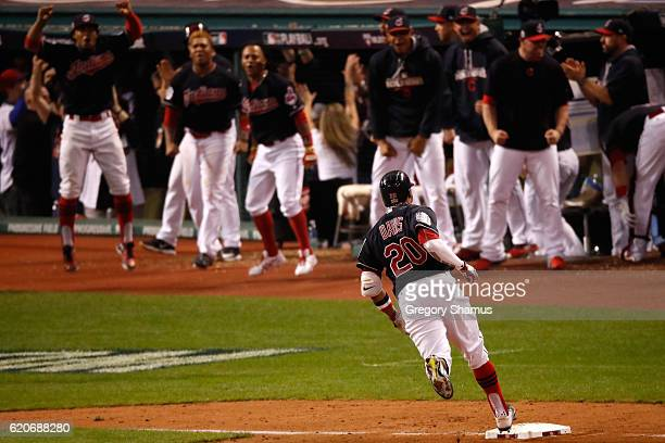 Rajai Davis of the Cleveland Indians runs the bases after hitting a tworun home run during the eighth inning to tie the game 66 against the Chicago...
