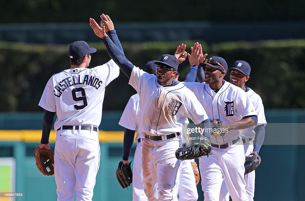 <a gi-track='captionPersonalityLinkClicked' href=/galleries/search?phrase=Rajai+Davis&family=editorial&specificpeople=810608 ng-click='$event.stopPropagation()'>Rajai Davis</a> #20 of the Detroit Tigers celebrates a win over the Los Angeles Angels of Anaheim with teammate <a gi-track='captionPersonalityLinkClicked' href=/galleries/search?phrase=Nick+Castellanos&family=editorial&specificpeople=6129175 ng-click='$event.stopPropagation()'>Nick Castellanos</a> #9 at Comerica Park on April 19, 2014 in Detroit, Michigan. The Angels defeated the Tigers 5-2.