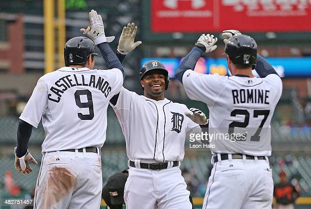 Rajai Davis of the Detroit Tigers celebrates after hitting a three run home run in the fourth inning scoring Nick Castellanos and Andrew Romine...