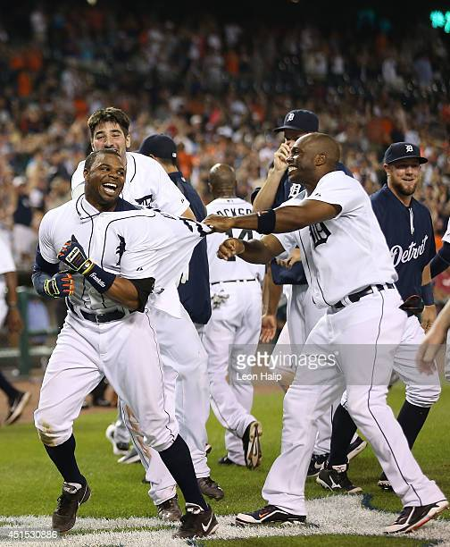 Rajai Davis of the Detroit Tigers celebrates with teammates after hitting a ninthinning grand slam to win the game over the Oakland Athletics at...