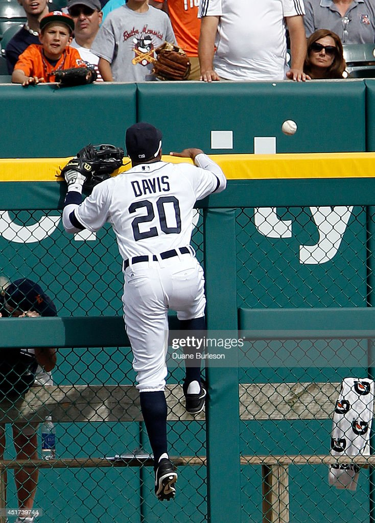 <a gi-track='captionPersonalityLinkClicked' href=/galleries/search?phrase=Rajai+Davis&family=editorial&specificpeople=810608 ng-click='$event.stopPropagation()'>Rajai Davis</a> #20 of the Detroit Tigers climbs the left field fence while chasing a home run hit by Logan Forsythe of the Tampa Bay Rays during the fifth inning at Comerica Park on July 5, 2014 in Detroit, Michigan.