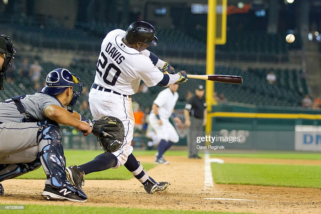 Rajai Davis of the Detroit Tigers hits a sacrifice fly in the thirteenth inning to drive in the winning run to defeat the Tampa Bay Rays 87 during a...
