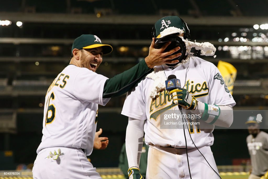 Rajai Davis #11 of the Oakland Athletics is hit with a pie by teammate Adam Rosales #16 of the Oakland Athletics after Davis hit a two-run walk-off home run in the 9th inning against the Minnesota Twins at Oakland Alameda Coliseum on July 29, 2017 in Oakland, California.