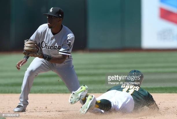 Rajai Davis of the Oakland Athletics steals second bases sliding in before the tag of Tim Anderson of the Chicago White Sox in the bottom of the six...