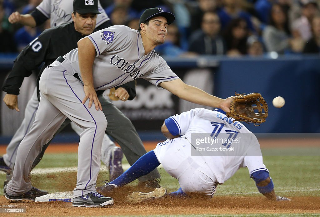 <a gi-track='captionPersonalityLinkClicked' href=/galleries/search?phrase=Rajai+Davis&family=editorial&specificpeople=810608 ng-click='$event.stopPropagation()'>Rajai Davis</a> #11 of the Toronto Blue Jays advances to third base on a groundout in the seventh inning during MLB game action as <a gi-track='captionPersonalityLinkClicked' href=/galleries/search?phrase=Nolan+Arenado&family=editorial&specificpeople=7934273 ng-click='$event.stopPropagation()'>Nolan Arenado</a> #28 of the Colorado Rockies waits for the ball on June 19, 2013 at Rogers Centre in Toronto, Ontario, Canada.