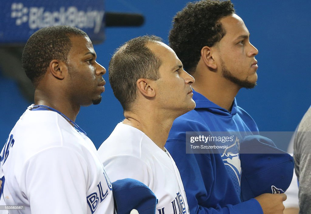 Rajai Davis #11 of the Toronto Blue Jays and Omar Vizquel #13 and fellow Venezuelan Henderson Alvarez #37 stand for the playing of the anthems before MLB game action against the Minnesota Twins on October 3, 2012 at Rogers Centre in Toronto, Ontario, Canada.