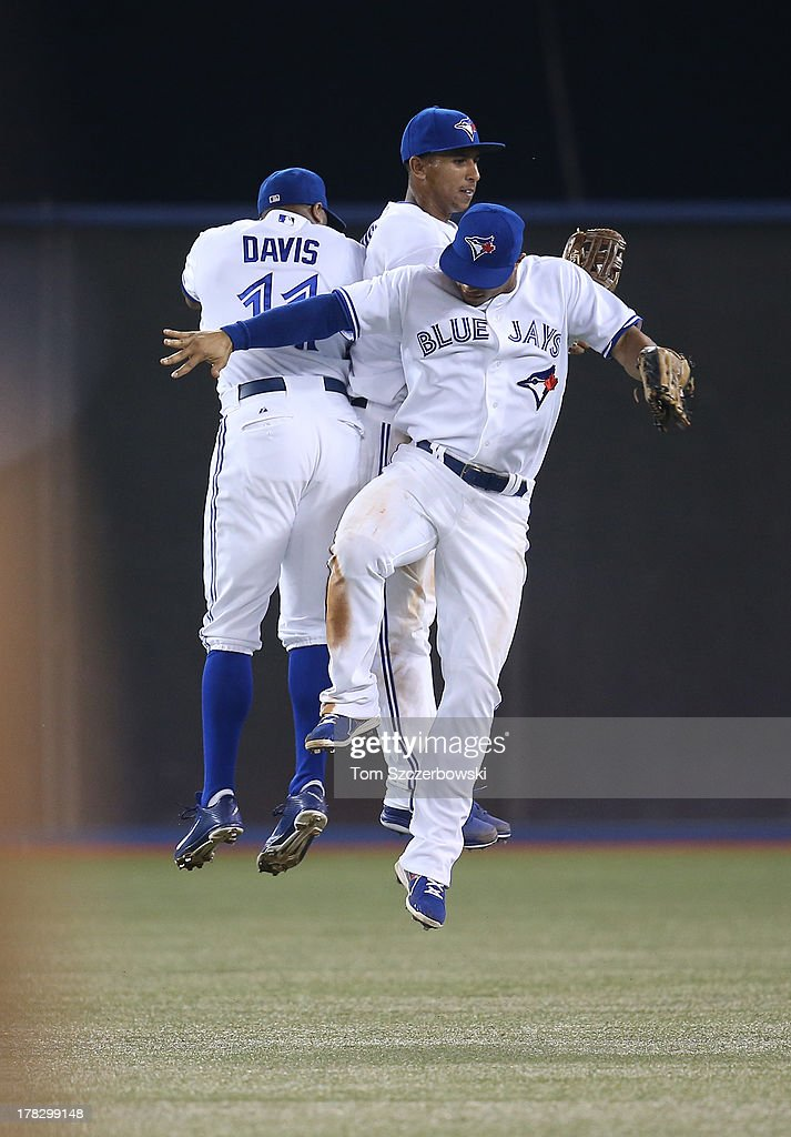 <a gi-track='captionPersonalityLinkClicked' href=/galleries/search?phrase=Rajai+Davis&family=editorial&specificpeople=810608 ng-click='$event.stopPropagation()'>Rajai Davis</a> #11 of the Toronto Blue Jays celebrates their victory with Anthony Gose #8 and <a gi-track='captionPersonalityLinkClicked' href=/galleries/search?phrase=Moises+Sierra&family=editorial&specificpeople=7509137 ng-click='$event.stopPropagation()'>Moises Sierra</a> #14 during MLB game action against the New York Yankees on August 28, 2013 at Rogers Centre in Toronto, Ontario, Canada.