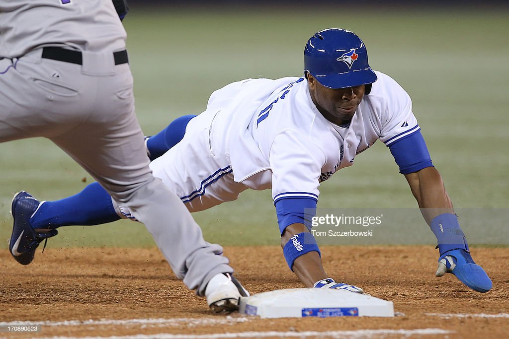 <a gi-track='captionPersonalityLinkClicked' href=/galleries/search?phrase=Rajai+Davis&family=editorial&specificpeople=810608 ng-click='$event.stopPropagation()'>Rajai Davis</a> #11 of the Toronto Blue Jays dives back to first base on a pick-off attempt during MLB game action against the Colorado Rockies on June 19, 2013 at Rogers Centre in Toronto, Ontario, Canada.