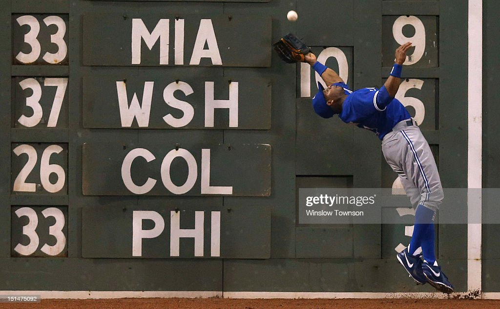 <a gi-track='captionPersonalityLinkClicked' href=/galleries/search?phrase=Rajai+Davis&family=editorial&specificpeople=810608 ng-click='$event.stopPropagation()'>Rajai Davis</a> #11 of the Toronto Blue Jays makes a catch against the wall and then doubled off a runner to complete a double play during the seventh inning of the game against the Boston Red Sox at Fenway Park on September 7, 2012 in Boston, Massachusetts.