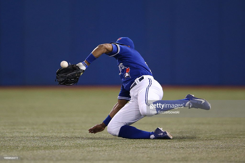 Rajai Davis #11 of the Toronto Blue Jays makes a sliding catch in right field in the fifth inning during MLB game action against the Boston Red Sox on April 7, 2013 at Rogers Centre in Toronto, Ontario, Canada.