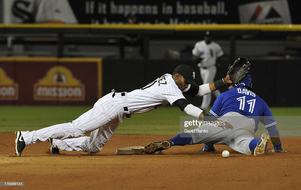<a gi-track='captionPersonalityLinkClicked' href=/galleries/search?phrase=Rajai+Davis&family=editorial&specificpeople=810608 ng-click='$event.stopPropagation()'>Rajai Davis</a> #11 of the Toronto Blue Jays steals second base as <a gi-track='captionPersonalityLinkClicked' href=/galleries/search?phrase=Alexei+Ramirez&family=editorial&specificpeople=690568 ng-click='$event.stopPropagation()'>Alexei Ramirez</a> #10 of the Chicago White Sox loses the ball during the tenth inning on June 11, 2013 at U.S. Cellular Field in Chicago, Illinois.