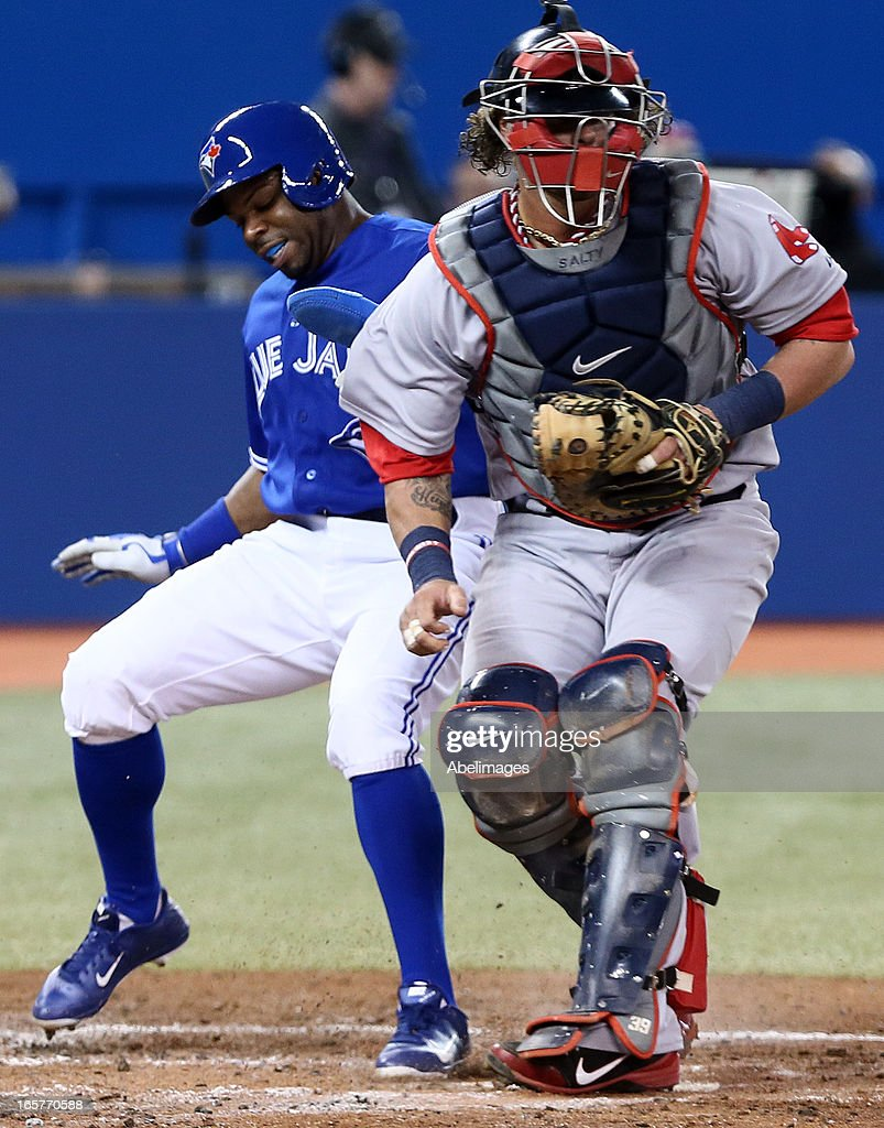 <a gi-track='captionPersonalityLinkClicked' href=/galleries/search?phrase=Rajai+Davis&family=editorial&specificpeople=810608 ng-click='$event.stopPropagation()'>Rajai Davis</a> #11 of the Toronto Blue Jays touches safe at home past <a gi-track='captionPersonalityLinkClicked' href=/galleries/search?phrase=Jarrod+Saltalamacchia&family=editorial&specificpeople=836404 ng-click='$event.stopPropagation()'>Jarrod Saltalamacchia</a> #39 of the Boston Red Sox in the second inning during MLB action at the Rogers Centre April 5, 2013 in Toronto, Ontario, Canada.