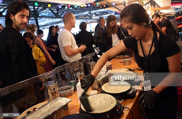 Rajani Khagi serves Indian dosas to visitors at the Art Berlin Contemporary fair on September 17 2015 in Berlin Germany The fair exhibits works from...