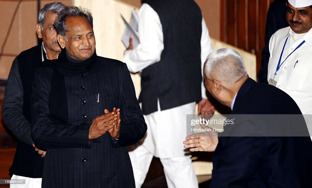 Rajasthan Chief Minister Ashok Gehlot greets the delegates during the Chintan Shivir at Birla Auditorium, Jaipur on January 18, 2013 in Rajasthan, India. The Congress' brain-storming session began in Jaipur today and the focus is on the 2014 elections and Rahul Gandhi's role in leading the party in the battle. The ruling party hopes to emerge from the two-day-long session armed with strategy on, among other things, how to reconnect with an angry urban middle class.