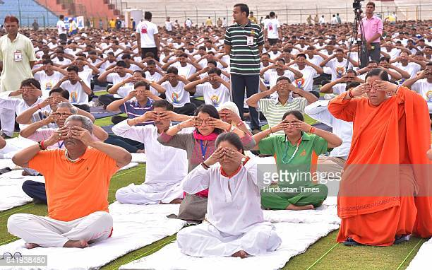 Rajasthan Chief Minister Vasundhara Raje along with Union Minister Uma Bharti and BJP leader Om Prakash Mathur with thousands of people performs Yoga...