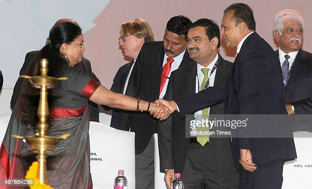 Rajasthan Chief Minister Vasundhara Raje being greeted by industrialists Anil Ambani Gautam Adani and Rakesh Mittal at the lamp lighting ceremony at...