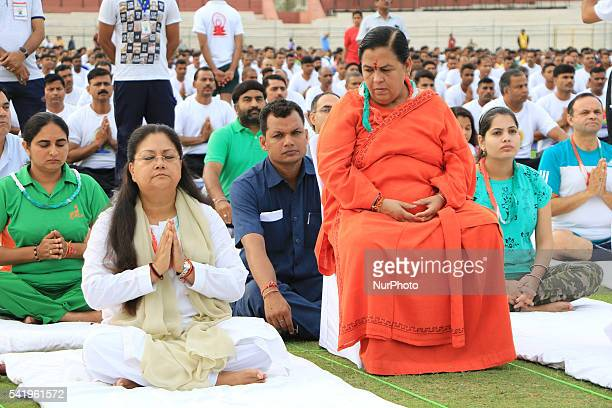 Rajasthan Chief Minister Vasundhara Raje with Union Water Resources Minister Uma Bharti and other ministers and people participate in Yoga Camp on...