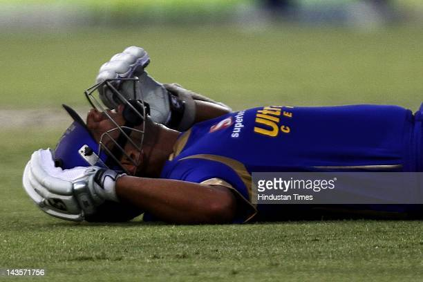 Rajasthan Royals batsman Rahul Dravid lying on ground wincing in pain as he pulls a muscle ls during the IPL 5 T20 cricket match against Delhi...