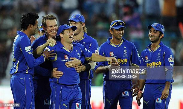 Rajasthan Royals bowler Johan Botha celebrates the wicket of Pune Warriors batsman Steven Smith with Bradley Hodge and other teammates during the IPL...