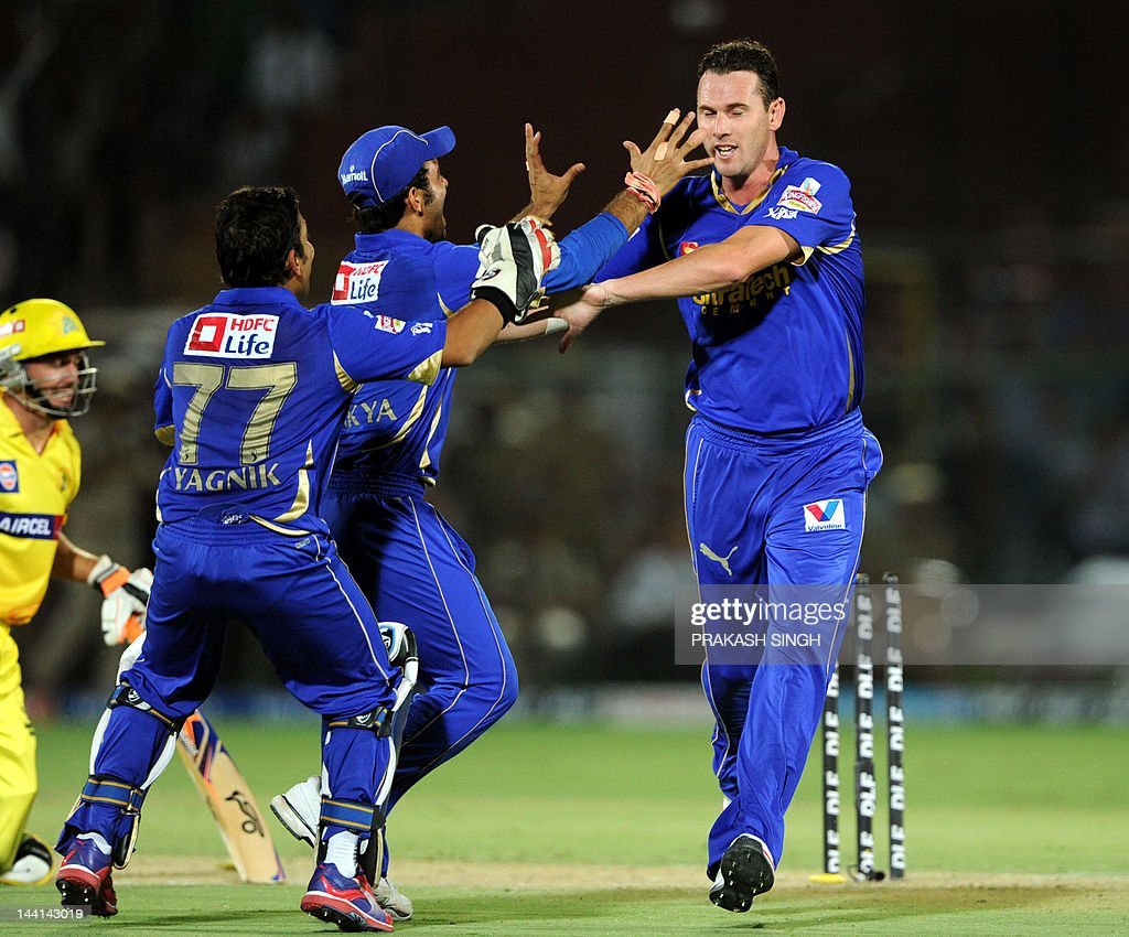 Rajasthan Royals bowler Shaun Tait (R) celebrates the runout of Chennai Super Kings batsman Michael Hussey during a IPL match between Rajasthan Royal s and Chennai Super King at Swai Mansingh stadium in Jaipur on May 10, 2012. RESTRICTED TO EDITORIAL USE. MOBILE USE WITHIN NEWS PACKAGE AFP photo/Prakash Singh PACKAGE