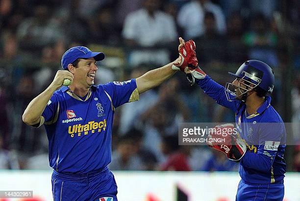 Rajasthan Royals' Bradley Hodge celebrates taking the wicket of Pune Warriors batsman Steven Smith with teammates during the IPL Twenty20 match...
