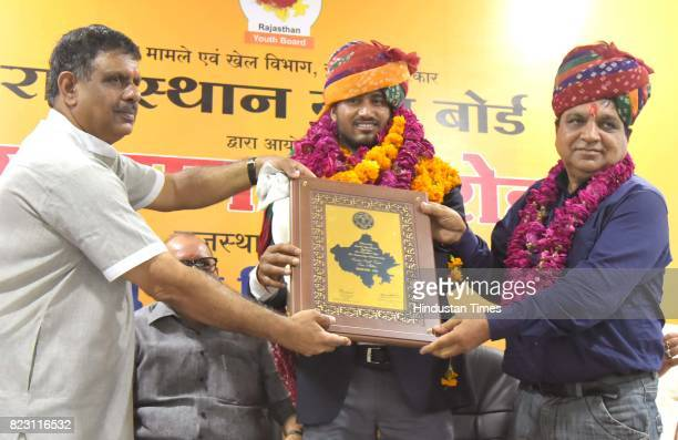 Rajasthan Sports Minister Gajendra Singh Khinvsar giving award to Sundar Singh Gujjar gold medalist World ParaAthletics Championships at SMS Stadium...