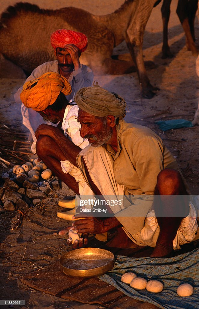 Rajasthani men making chapatis at the Camel Fair.
