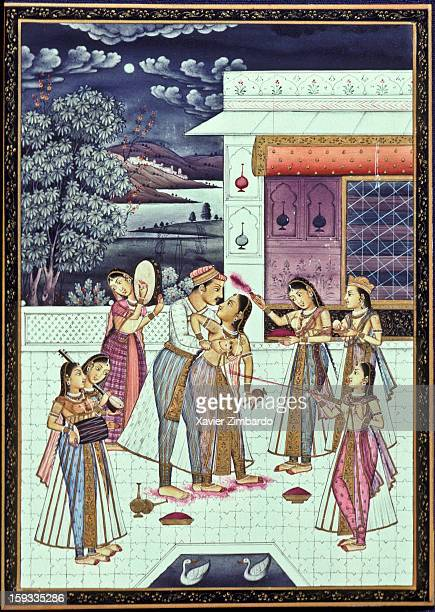 Rajasthani miniature shows a joyous scene depicting Holi the oldest among Hindu festivals where a prince and his princess are standing amidst maidens...