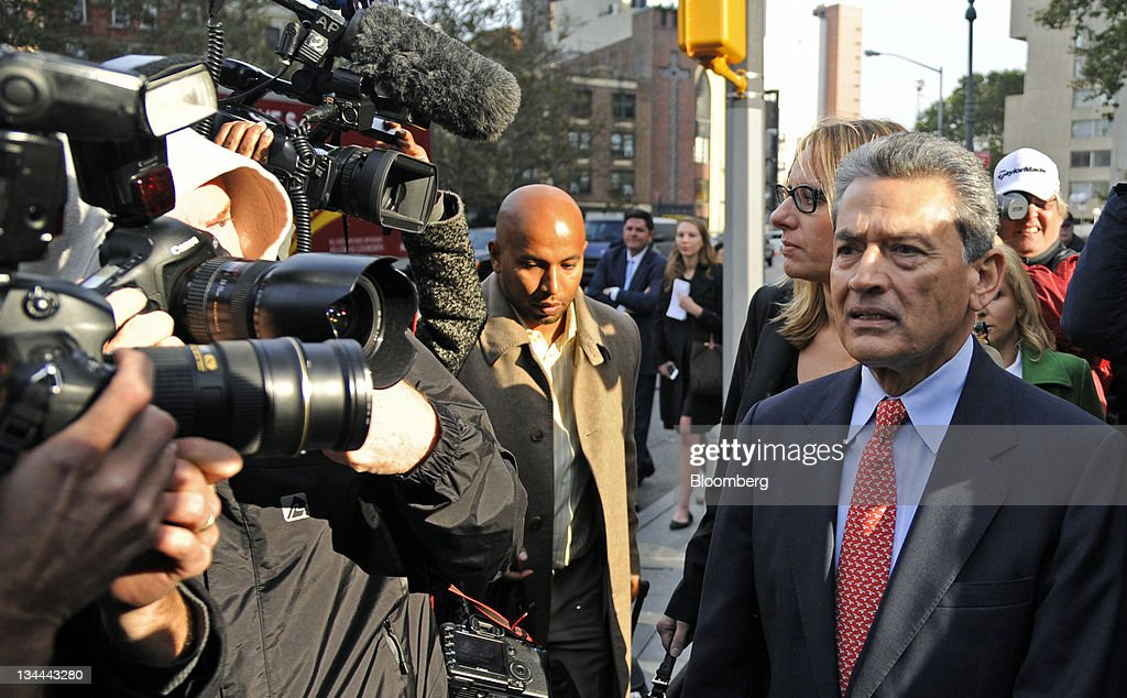Rajat Gupta, former Goldman Sachs Inc. director and former senior partner at McKinsey & Co., right, exits federal court in New York, U.S., on Wednesday, Oct. 26, 2011. Gupta was indicted for conspiracy and securities fraud, making him the highest-ranking executive charged in a nationwide crackdown on insider trading centered on Raj Rajaratnam, co-founder of hedge fund Galleon Group LLC. Photographer: Peter Foley/Bloomberg via Getty Images