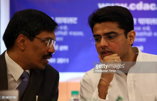 Rajat Moona and Sachin Pilot Ministry of State Ministry of Communication and Information Technology Government of India chat during the launch of...